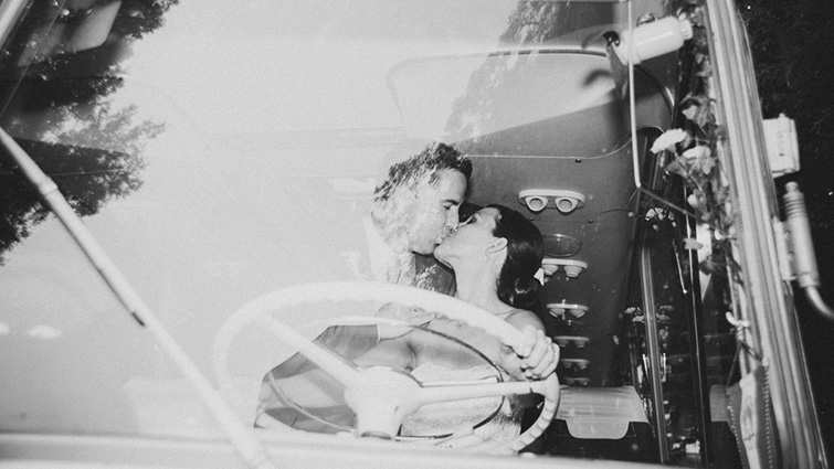wedding couple kiss in the bus
